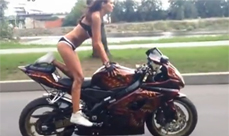 Yoga girl doing amazing stunts on a Suzuki motorbike