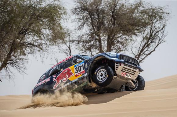 Driving X-Raid Mini All4 Racing rally car in the Dubai desert