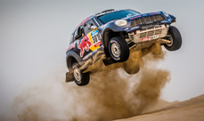 Driving X-Raid Mini All4 Racing rally car in the Dubai desert